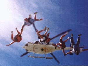 Baja, Micheal Jernigan, Tracy George, Renaté Di Noia, and Jerry Hoekstra diving from a helicopter